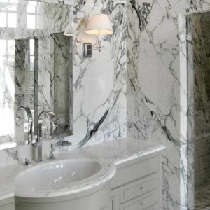 Bathroom in book matched Breccia Capraia