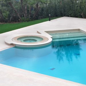 Pool facing in brushed and flamed Rocheron doree stone